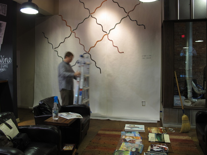 (October 6, 2012: Mark Creegan works on his installation at Bold Bean Coffee. The popular Stockton St. coffeehouse has given Bu Shea creative carte blanche to host works by local artists.)