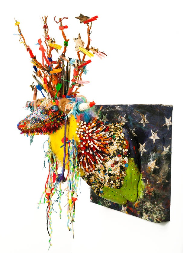 "[""Anton Rocamora,"" foam, fabric, plastic, limbs, clothes pins, various papers, pins, fur, paint brush, acrylic, buttons, cork, etc... on panel; 43"" x 37"" x 31""; 2011.]"